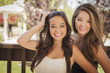 Attractive Mixed Race Girlfriends Smile Outdoors