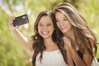 Attractive Mixed Race Girlfriends Taking Self Portrait with Came