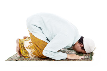 Muslim man prostrating in praying