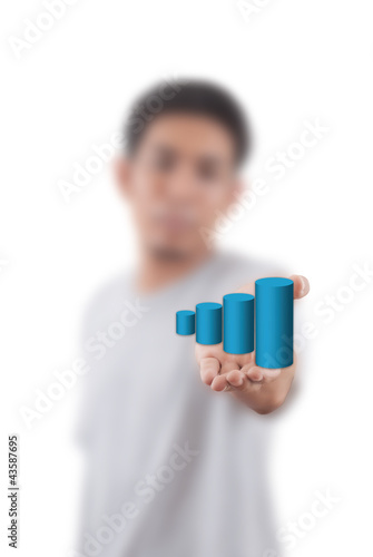 Businessman Holding Graph.