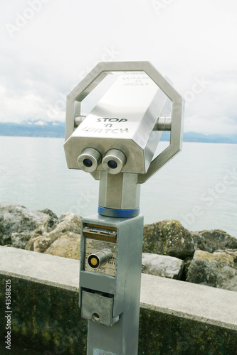 Silver coin operated pay binoculars