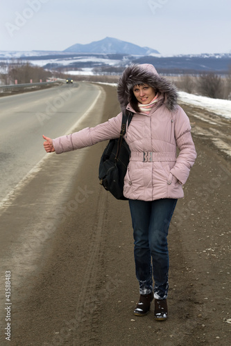 Travel woman hitchhiking.