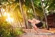 Man with dreadlocks doing yoga