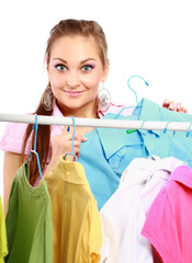Stylish young girl trying on clothes in clothing store isolated