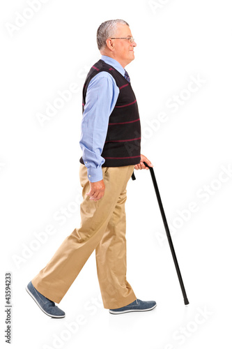 Full length portrait of a senior man walking with cane