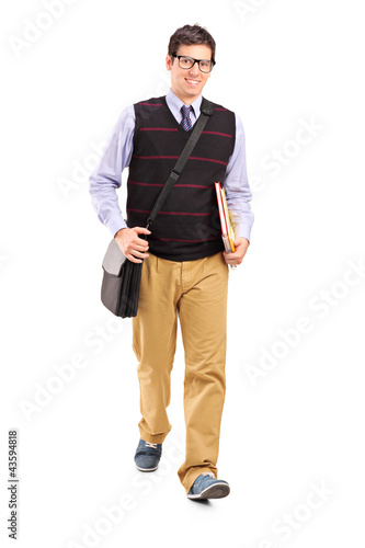Student walking with notebooks in his hand