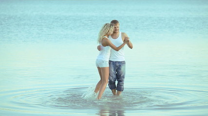 Cheerful couple doing elegance dance in the summer sea