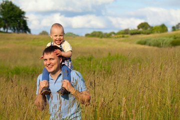 father and child on summer field