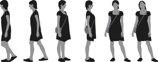 Walking young woman in dress