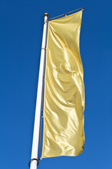 Empty vertical banner golden flag