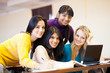 group of young female college students using laptop