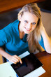 attractive young female university student using tablet computer