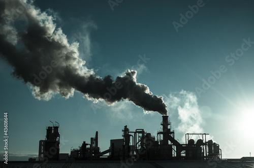 Fotobehang Koraalriffen Smoking chimney at sunset