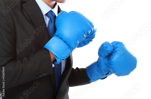 businessman with boxing glove ready to fight