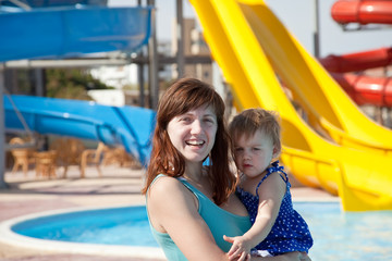 mother with  toddler at aquapark