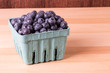 Blueberries in container on table
