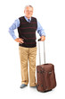 Full length portrait of a mature man holding a suitcase