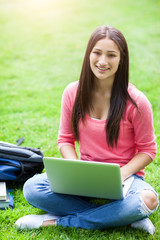 Hispanic college student with laptop