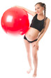 pregnant young woman doing exercise on fitball