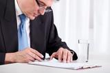 Senior businessman checking contract