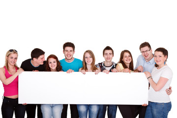 group of friends standing together with white billboard