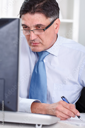 mature business man working on computer