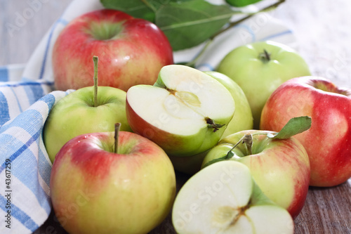 Red and green apples with leaves