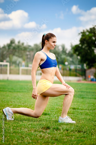 Woman runner stretching
