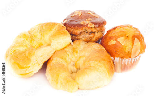 butter croissant with freshly mixed muffin on the white backgrou