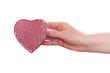 Rotes Herz in einer weiblichen Hand