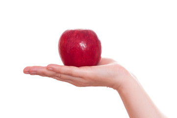 Roter Apfel in einer Hand