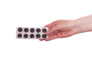 Weibliche Hand reicht Medikament