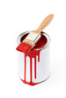 Full of red paint tin and paint brush with red ink