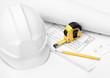 White hard hat, tape measure and pencil