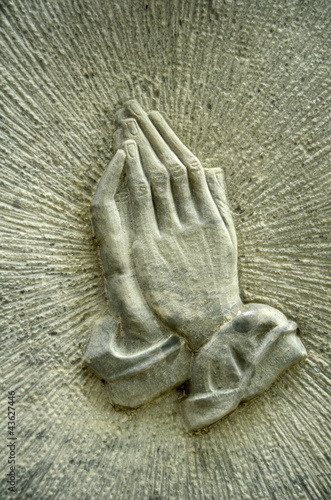 Christian Image Of Jesus' Praying Hands On A Gravestone
