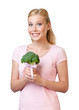 Pretty woman holding broccoli, isolated