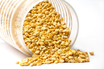 Dried yellow peas in glass jar