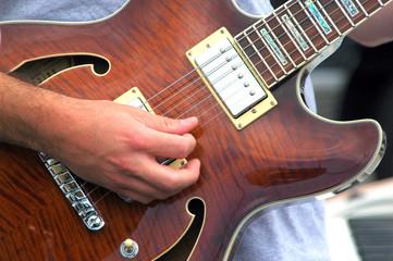 Male guitarist.