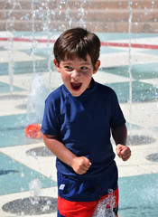 Young boy playing in the water