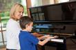 Leinwanddruck Bild - Piano teacher and student