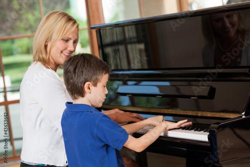 Leinwanddruck Bild Piano teacher and student