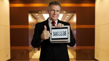 businessman holds tablet that says success