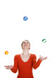 Woman juggling with three balls