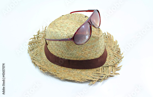 Beach hat and sunglasses isolated on white background