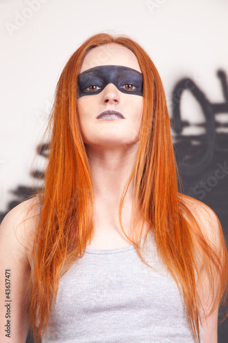 young Redheaded female with artistic makeup
