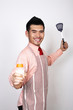 Businessman in apron holding baby bottle and ladle