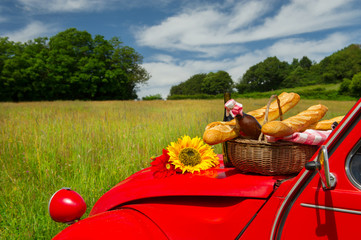 French car with bread and wine