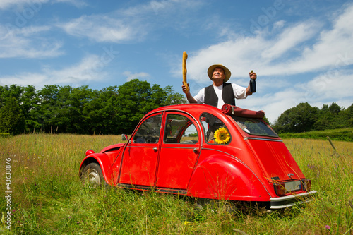 French man with his typical red car