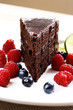 Chocolate cake and berries on a plate