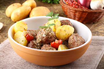 Meatballs with tomato sauce with potatoes in broth